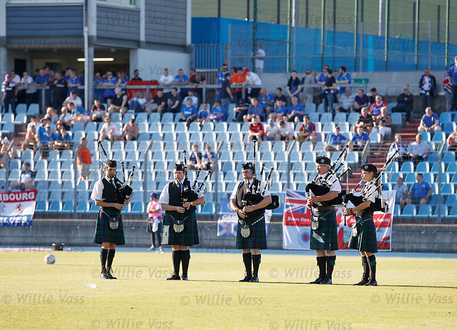 Bagpipers belting out Flower of Scotland