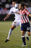 Real Salt Lake's (14) Yura Movsisyan and Chivas USA's (12) Carey Talley battle for the ball in the first half at the Home Depot Center in Carson, CA on Saturday, May 9, 2009..