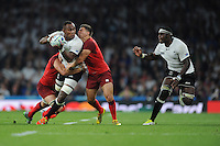 Leone Nakarawa of Fiji looks to offload to Apisalome Ratuniyarawa of Fiji as he is tackled by Ben Youngs and Tom Wood of England during Match 1 of the Rugby World Cup 2015 between England and Fiji - 18/09/2015 - Twickenham Stadium, London <br /> Mandatory Credit: Rob Munro/Stewart Communications
