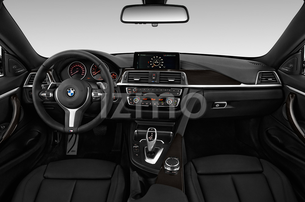 Stock photo of straight dashboard view of a 2019 BMW 4 series M Sport 2 Door Coupe
