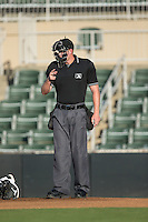 Home plate umpire Mike Carroll makes a strike call during the South Atlantic League game between the Greenville Drive and the Kannapolis Intimidators at Intimidators Stadium on June 8, 2016 in Kannapolis, North Carolina.  The Intimidators defeated the Drive 3-2.  (Brian Westerholt/Four Seam Images)