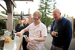 Michael Dickson, of Wisconsin, tries a variety of apple ciders, with friends, Jonathon Dowling, left, and hotel partner Roger Scommegna, at the Boonville Hotel, in Boonville, Ca., on Sunday, Oct. 10, 2010.