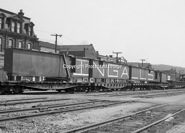 Oakmont PA:  View of an Ingalls Steel girder being transported by the Pennsylvania Railroad at the Oakmont Station.  The structual beam was fabricated the Ingalls Iron Works for use in highway construction.