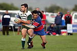 Manurewa flanker V. Roight is tackled by R Afoa-Peterson.   Counties Manukau Premier Club Rugby, Ardmore Marist vs Manurewa played at Bruce Pulman Park, Papakura on the 10th of June 2006. Ardmore Maris won 18 - 11.