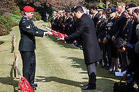 A Canadian soldier hands a poppy wreath to representative of the Commonwealth military at a Remembrance Day ceremony at the Yokohama War Cemetery, Hodogaya. Yokohama, Japan. Sunday November 9th 2014