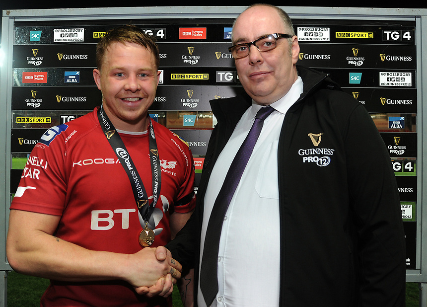 Scarlets' James Davies receives his man of the match award from Martin Clemson <br /> <br /> Photographer Ashley Crowden/CameraSport<br /> <br /> Guinness PRO12 Round 19 - Scarlets v Benetton Treviso - Saturday 8th April 2017 - Parc y Scarlets - Llanelli, Wales<br /> <br /> World Copyright &copy; 2017 CameraSport. All rights reserved. 43 Linden Ave. Countesthorpe. Leicester. England. LE8 5PG - Tel: +44 (0) 116 277 4147 - admin@camerasport.com - www.camerasport.com