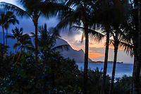 The sun sets behind Mount Makana (or Bali Hai) and Hanalei Bay, as seen from Princeville, Kaua'i.