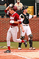 NASHVILLE, TENNESSEE-Feb. 27, 2011:  Stephen Piscotty of Stanford touches home plate following his first home run of the season during the game at Vanderbilt.  Stanford defeated Vanderbilt 5-2.