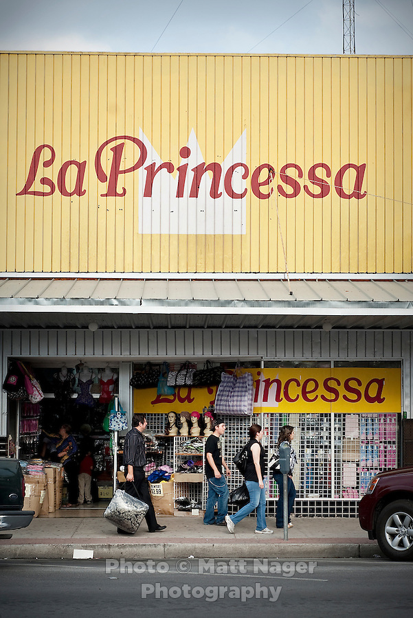 Shoppers stroll along Main Street in downtown McAllen, Texas, Sunday, April 4, 2010. Downtown McAllen stores don't sell designer or name brand items, but still reach a wide customer base for McAllen residents and visiting Mexican tourists. ...PHOTO/ Matt Nager
