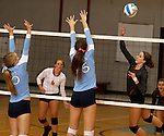 SIOUX FALLS, SD - SEPTEMBER 16: Michelle Haas #10 and Anezka Szabo #16 from Lincoln try for a block on Rochelle Ramharter #3 from Washington in the first game of their match Tuesday night at Lincoln.  (Photo by Dave Eggen/Inertia)