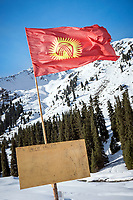 A Kyrgyzstan flag flies at a backcountry yurt camp in the Aksuu Valley