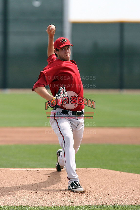 Tyler Skaggs #31 of the Arizona Diamondbacks pitches in a minor league spring training game against the Cincinnati Reds at Salt River Fields on March 15, 2011  in Scottsdale, Arizona. .Photo by:  Bill Mitchell/Four Seam Images.
