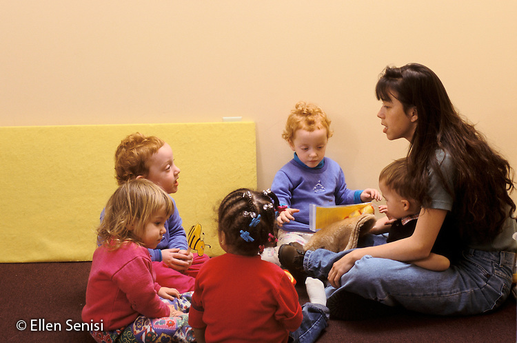 MR / Schenectady, NY.Schenectady Day Nursery; private, non-profit daycare / Toddler Class..Aide (Chinese-American / Caucasian) and students aged 18-30 months do language activity..MR: SDN-8.PN#: 25894                  FC#: 22148-00511.scan from slide.©Ellen B. Senisi