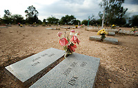 The final two grave markers made at the Pima County Fiduciary Cemetery show the resting place for unidentified deaths at Evergreen Cemetery for burial in Tucson, Arizona, Tuesday, August 12, 2009. In late 2004, Pima County ruled that bodies found in the desert can be cremated to accommodate for the lack of plot space in the cemetery...PHOTOS/ MATT NAGER