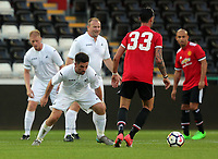 Andy Upperton of Swansea Legends against Chris Eagles of Manchester United Legends (33) during the Alan Tate Testimonial Match, Swansea City Legends v Manchester United Legends at the Liberty Stadium, Swansea, Wales, UK