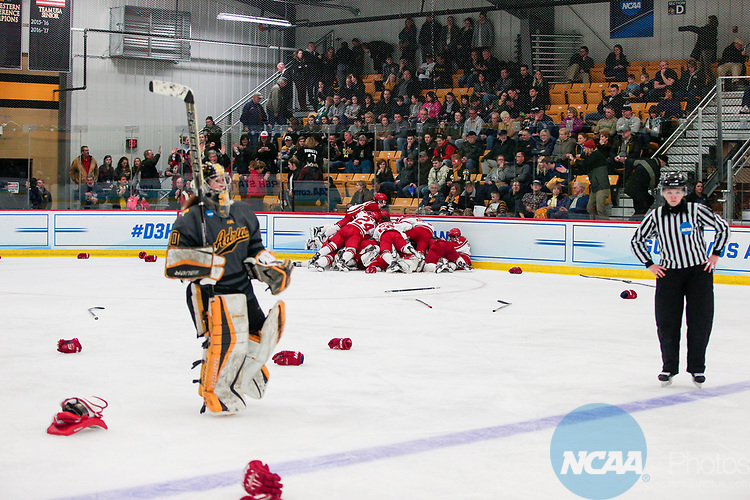 ADRIAN, MI - MARCH 18: The Plattsburgh State team celebrate on the ice as Adrian goalkeeper Brooke Gibson (30) skates off after the Division III Women's Ice Hockey Championship held at Arrington Ice Arena on March 19, 2017 in Adrian, Michigan. Plattsburgh State defeated Adrian 4-3 in overtime to repeat as national champions for the fourth consecutive year. by Tony Ding/NCAA Photos via Getty Images)