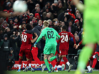 30th October 2019; Anfield, Liverpool, Merseyside, England; English Football League Cup, Carabao Cup, Liverpool versus Arsenal; the Liverpool players celebrate with penalty shootout hero Caoimhin Kelleher  - Strictly Editorial Use Only. No use with unauthorized audio, video, data, fixture lists, club/league logos or 'live' services. Online in-match use limited to 120 images, no video emulation. No use in betting, games or single club/league/player publications