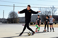 "NWA Democrat-Gazette/CHARLIE KAIJO Coach Jacob Rutledge demonstrates a soccer skill, Monday, November 25, 2019 during a two-day soccer skills camp at The Strike Zone Training Academy in Rogers.<br /> <br /> Coaches led their second annual Thanksgiving, skills camp to teach kids soccer skills like first touch (how to receive the ball) and finishing (taking a quick, powerful shot). ""It's not something focused on enough in youth soccer,"" said Courtney Heinlich, owner of Strike Zone Training Academy."