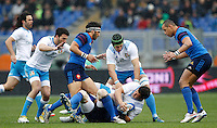 Rugby, Torneo Sei Nazioni: Italia vs Francia. Roma, stadio Olimpico, 15 marzo 2015.<br /> Italy's Luca Morisi, bottom, holds the ball during the Six Nations championship rugby match between Italy and France at Rome's Olympic stadium, 15 March 2015.<br /> UPDATE IMAGES PRESS/Riccardo De Luca