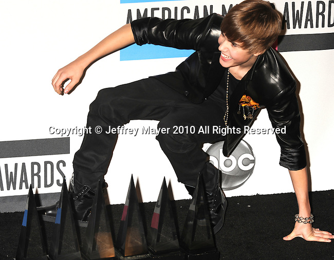 LOS ANGELES, CA. - November 21: Justin Bieber poses in the press room during the 2010 American Music Awards held at Nokia Theatre L.A. Live on November 21, 2010 in Los Angeles, California.