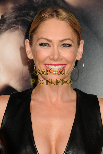 "Kym Johnson.""The Words"" Los Angeles Premiere held at Arclight Cinemas, Hollywood, California, USA..September 4th, 2012.headshot portrait  black leather gold hoop earrings pink lipstick low cut neckline cleavage sleeveless .CAP/ADM/BP.©Byron Purvis/AdMedia/Capital Pictures."