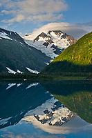 Chugach mountains reflect in Portage lake, southcentral, Alaska.