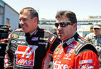 Apr 17, 2009; Avondale, AZ, USA; NASCAR Sprint Cup Series driver Tony Stewart (right) with teammate Ryan Newman during practice for the Subway Fresh Fit 500 at Phoenix International Raceway. Mandatory Credit: Mark J. Rebilas-