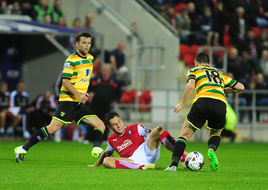 Rotherham United's Joe Newell slides in to tackle Norwich City's Graham Dorrans<br /> <br /> Photographer Andrew Vaughan/CameraSport<br /> <br /> Football - Capital One Cup Second Round - Rotherham United v Norwich - Tuesday 25th August 2015 - New York Stadium - Rotherham<br />  <br /> &copy; CameraSport - 43 Linden Ave. Countesthorpe. Leicester. England. LE8 5PG - Tel: +44 (0) 116 277 4147 - admin@camerasport.com - www.camerasport.com