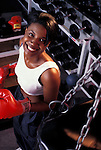 portrait of attractive young black woman during workout at health club