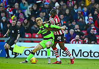 Forest Green Rovers' Nathan McGinley shields the ball from  Lincoln City's John Akinde<br /> <br /> Photographer Andrew Vaughan/CameraSport<br /> <br /> The EFL Sky Bet League Two - Lincoln City v Forest Green Rovers - Saturday 3rd November 2018 - Sincil Bank - Lincoln<br /> <br /> World Copyright &copy; 2018 CameraSport. All rights reserved. 43 Linden Ave. Countesthorpe. Leicester. England. LE8 5PG - Tel: +44 (0) 116 277 4147 - admin@camerasport.com - www.camerasport.com