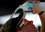 ST. PETERSBURG, FL - JUNE 18:  Emily Day pour water on her head during her and Jennifer Kessy's loss to Maria Clara/Carol of Brazil  during the FIVB Beach Volleyball World Tour St. Petersburg Grand Slam presented by the AVP on June 18, 2015 at Spa Beach in St. Petersburg, Florida. (Photo by Donald Miralle for the AVP)