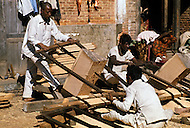 February 1975, Pokhara area, Nepal. Daily life. Street scene of carpenters making boards.