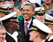 United States President Barack Obama smiles as he watches the 112th meeting of the United States Army Black Knights and the U.S. Navy Midshipmen on the Navy side of the field at FedEx Field in Landover, Maryland on Saturday, December 10, 2011..Credit: Ron Sachs / CNP