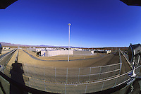 Prison housing units, new prison construction in the Western United States, overview from guard tower at fence line. Western United States.