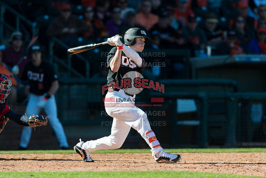 Oregon State Beavers left fielder Joe Casey (6) follows through on his swing during a game against the Gonzaga Bulldogs on February 16, 2019 at Surprise Stadium in Surprise, Arizona. Oregon State defeated Gonzaga 9-3. (Zachary Lucy/Four Seam Images)