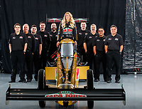 Jan 9, 2018; Brownsburg, IN, USA; NHRA top fuel driver Leah Pritchett and crew members pose for a portrait during a photo shoot at Don Schumacher Racing. Mandatory Credit: Mark J. Rebilas-USA TODAY Sports