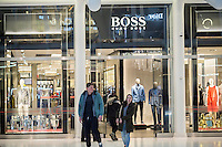 The Hugo Boss store in the Oculus shopping mall in the World Trade Center Transportation Hub in New York on Monday, January 2, 2017. Hugo Boss recently announced that the company will lower their aspirations to become a luxury brand and focus primarily on being a premium brand. (© Richard B. Levine)