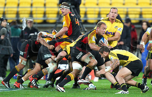 17.03.2013 Wellington, New Zealand. Chiefs' Matt Vant Leven on the attack as Hurricanes' TJ Perenara makes the tackle during the 2013 Super Rugby season - Hurricanes v Chiefs, Westpac Stadium...