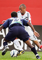 D.C. United's Earnie Stewart is marked by the New England Revolution's Marshall Leonard. The New England Revolution and D.C. United finished in a scoreless tie in MLS play at Gillette Stadium, Foxboro, MA on Saturday August 28, 2004.