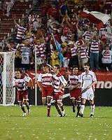 FC Dallas players David Wagenfuhr (16), Abe Thompson (7), Drew Moor (14), and Arturo Alvarez (12) celebrate a goal.  New England Revolution defeated FC Dallas 3-2 to capture the 2007 Lamar Hunt U.S. Open Cup at Pizza Hut Park in Frisco, TX on October 3, 2007.