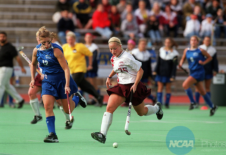 5 Nov 2000:  Lock Haven University forward Erika Grap (25) battles with Jennifer MacNeill (12) of Bentley College  during the Division II Women's Field Hockey Championship held at Charlotte Smith Field on the Lock Haven University campus in Lock Haven, PA.  Lock Haven defeated Bentley College 2-0 for the national title.  Thomas E. Witte/NCAA Photos