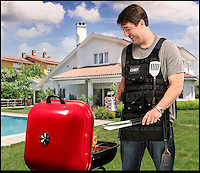 BNPS.co.uk (01202) 558833<br /> Picture: ThinkGeek.com<br /> <br /> The humble kitchen apron has been given a manly makeover - transforming it into the ultimate barbecue accessory. Millions of Brits will be firing up their barbecues to make the most of the glorious summer weather while it lasts - but only the most serious cooks will require the &pound;22 Tactical BBQ Apron. Looking more like a commando flak jacket than a pinny, it boasts enough pockets to pack the contents of a kitchen drawer into. The apron is made out of heavy grade cotton to protect grillers from the nastiest of fat splatters or spitting charcoal. It boasts a military-style Modular Lightweight Load-carrying Equipment system allowing wearers to customise its five pouches. Adjustable shoulder and waist straps mean it can fit a range of body shapes while a series of D-rings provide the perfect place from which to hang utensils.