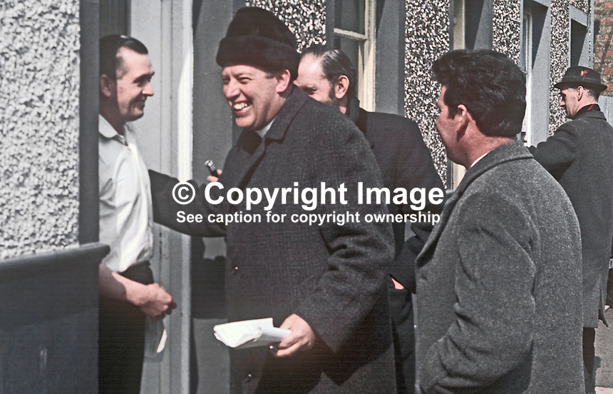 Rev Ian Paisley canvassing as the Protestant Unionist candidate in the Bannside, Co Antrim, constituency by-election of 16th April 1970 caused by the resignation of Terence O'Neill, the sitting MP. He had resigned the previous year as N Ireland's Prime Minister being succeeded by Major James Chichester-Clark. 197004000113c<br /> <br /> Copyright Image from Victor Patterson,<br /> 54 Dorchester Park, Belfast, UK, BT9 6RJ<br /> <br /> t1: +44 28 90661296<br /> t2: +44 28 90022446<br /> m: +44 7802 353836<br /> <br /> e1: victorpatterson@me.com<br /> e2: victorpatterson@gmail.com<br /> <br /> For my Terms and Conditions of Use go to<br /> www.victorpatterson.com