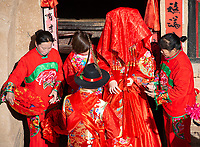 Performers re-enact a traditional wedding procession in the Sanmenxia pit yards.