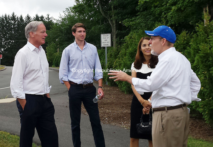 Thomas C. Foley, Republican candidate for Connecticut governor, left, campaigns outside Plantsville Elementary School in Southington Tuesday afternoon with his wife, oldest son and Joe Markley, in hat. Paul Hughes Republican-American