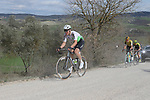 The peloton give chase on sector 8 Monte Santa Maria during Strade Bianche 2019 running 184km from Siena to Siena, held over the white gravel roads of Tuscany, Italy. 9th March 2019.<br /> Picture: Eoin Clarke | Cyclefile<br /> <br /> <br /> All photos usage must carry mandatory copyright credit (© Cyclefile | Eoin Clarke)