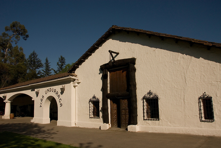 Chile Wine Country: Undurraga Winery, Vina Undurraga, near Santiago.  Horizontal of white winery building. .Photo #: ch409-32811..Photo copyright Lee Foster, 510-549-2202, www.fostertravel.com, lee@fostertravel.com.