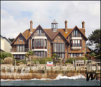 BNPS.co.uk (01202) 558833<br /> Pic: Tailormade/BNPS<br /> <br /> Harry Redknapps former home is now available for offers around &pound;10 million.<br /> <br /> &pound;100 million pound row...<br /> <br /> Lucky 13 - This tiny 850 ft stretch of seafront on the exclusive Sandbanks peninsular in Dorset is now thought to be the most expensive seaside real estate in the world.<br /> <br /> The 850ft long stretch of Panorama Road that boasts uninterupted views to the south west contains only 13 harbourside mansions that total a staggering &pound;92.7m in value.<br /> <br /> There is also almost total privacy from the road out front while back gardens run down to the water's edge.<br /> <br /> But the plots are relatively narrow, ranging between 40ft and 60ft wide, making it the most expensive piece of coastline in the world in term of price per square foot.