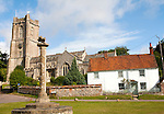Church of St Michael and butter cross on the village green in Aldbourne, Wiltshire, England