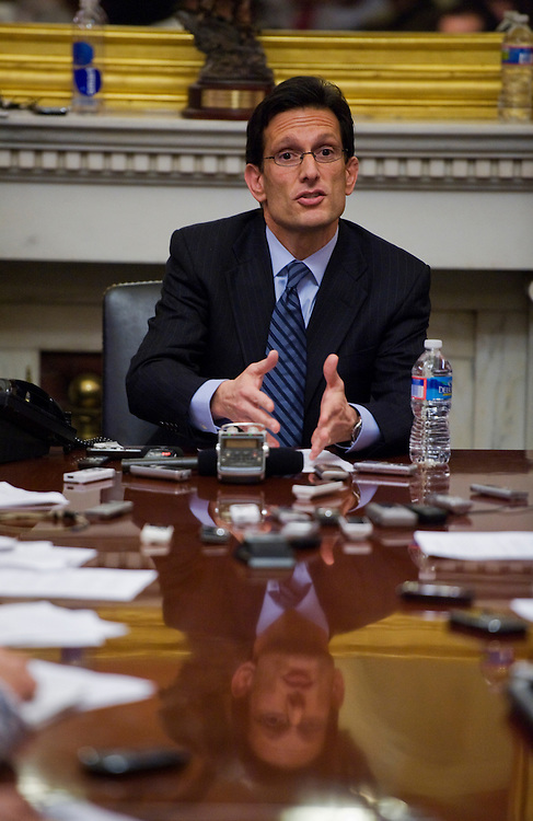 UNITED STATES - JANUARY 18:  House Majority Leader Eric Cantor, R-Va., answers questions at his weekly pen and pad briefing with reporters on the third floor of the Capitol to discuss upcoming business in the House including a vote on repeal of the health care reform law.  (Photo By Tom Williams/Roll Call)
